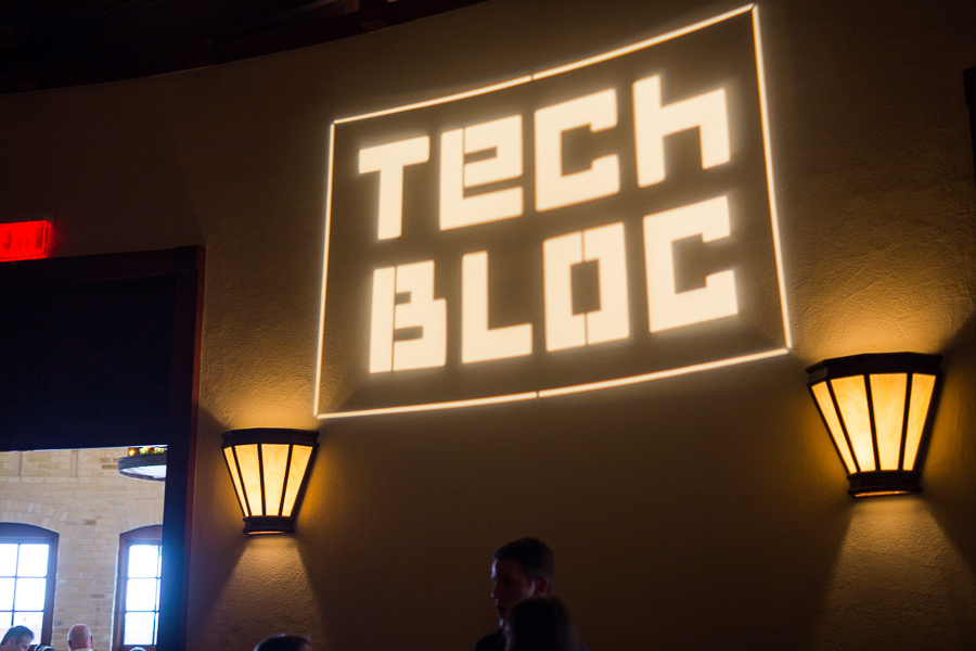 The Tech Bloc logo illuminates the walls of the Pearl Stable. Photo by Scott Ball.