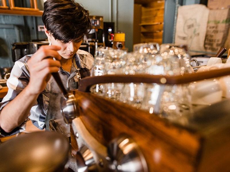 Head barista, Dorian Arcos uses a custom wooden Slayer branded espresso machine. Photo by Scott Ball.