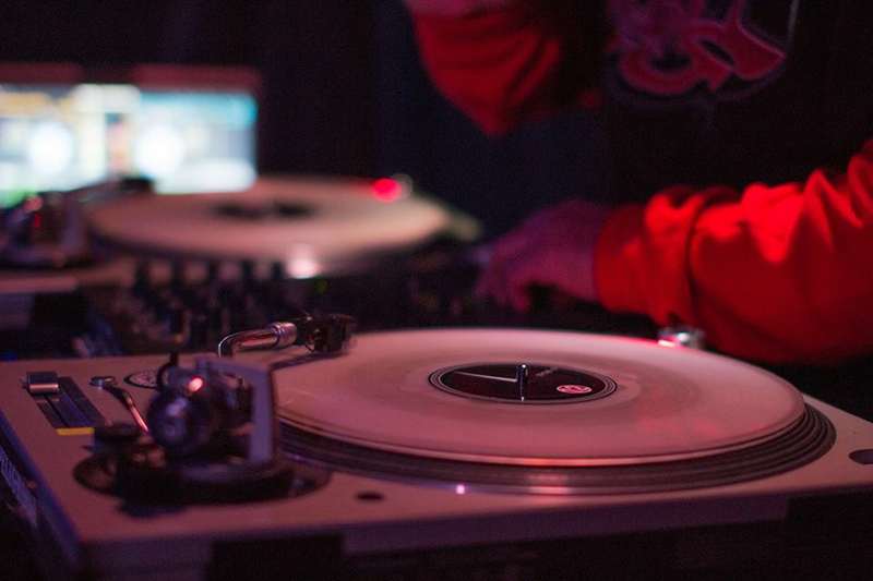 A local dj works at his turntable during a local music night called Hip Hop 101. Photo by Jerimey Sharp.