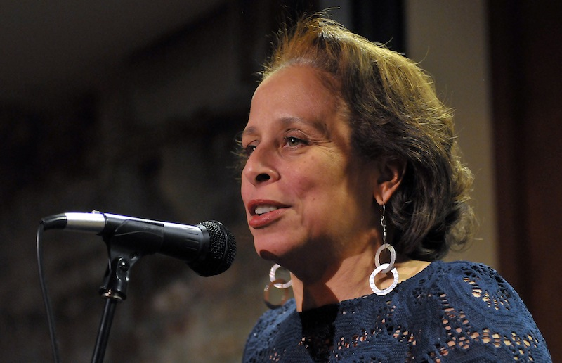 Veronique Le Melle introduces a speaker at a BCA event honoring Michael Wasserman. Photo by Craig Bailey.