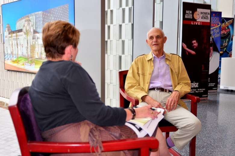 Mel Weingart talks with Tami Kegley at the Tobin Center. Photo by Page Graham.
