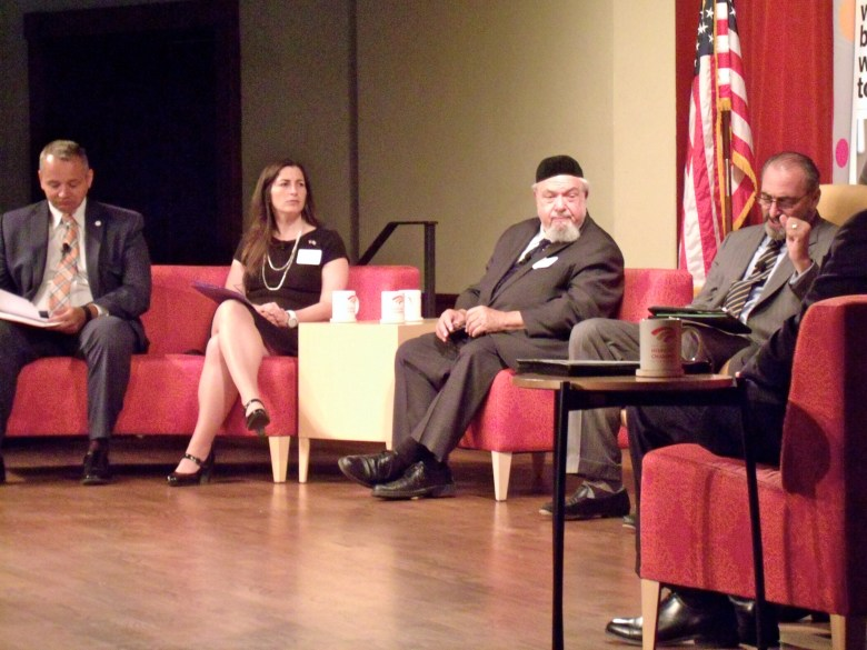 """Moderator Winslow Swart (far right) makes a point From left are J. Antonio Fernandez, president/CEO of Catholic Charities, Ronit Sherwin, CEO of Jewish Federation of San Antonio, and Rabbi Aryeh Scheinberg of Congregation Rodfei Sholom during """"A Community Conversation: Preventing Hate Crimes"""" at the Pearl Stable on Tuesday, Sept. 1, 2015. Photo by Edmond Ortiz."""