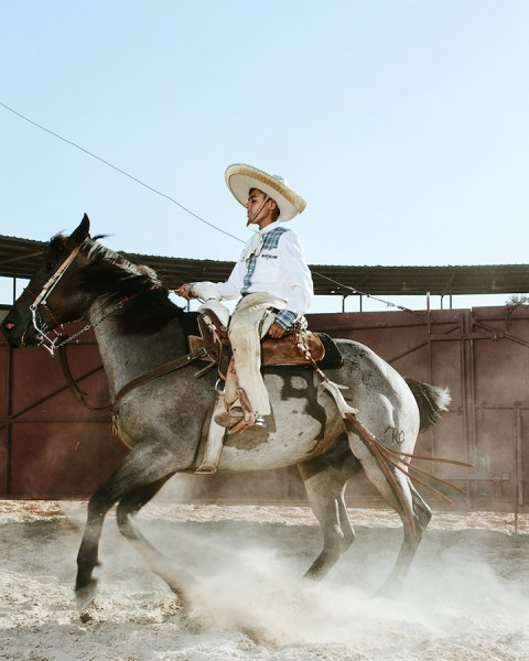 A charro gallops through the sandy landscape. Photo by Josh Huskin.