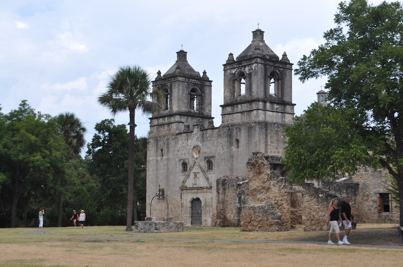 Visitors stroll the grounds of Mission Concepción. Photo by Iris Dimmick.