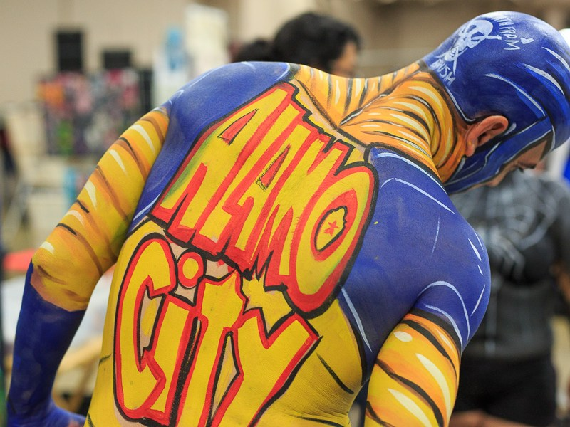 A recently body painted guest wears the Alamo City Comic Con logo. Photo by Scott Ball.