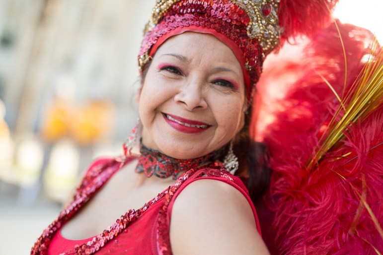 Brazilian dancer Margie Arzola smiles as she dances. Photo by Scott Ball.