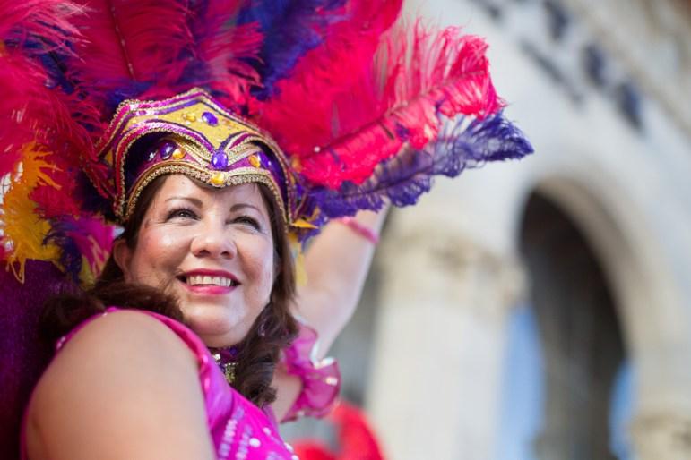 Brazilian dancer Dora Guitiérrez dances in front of the Tobin Center. Photo by Scott Ball.