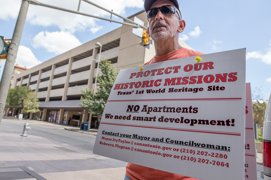 Armando Santiago stands outside the Hyatt Regency protesting the construction of apartments outside of the missions. Photo by Scott Ball.