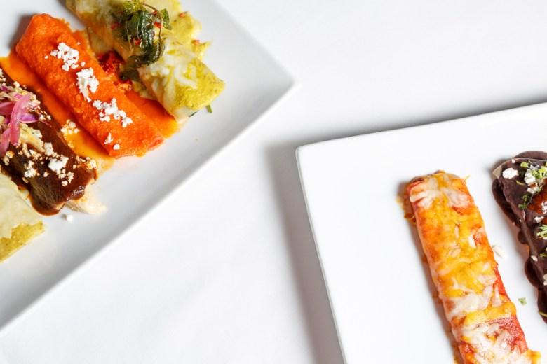 Plates of enchiladas prepared at La Fonda. Photo by Scott Ball.