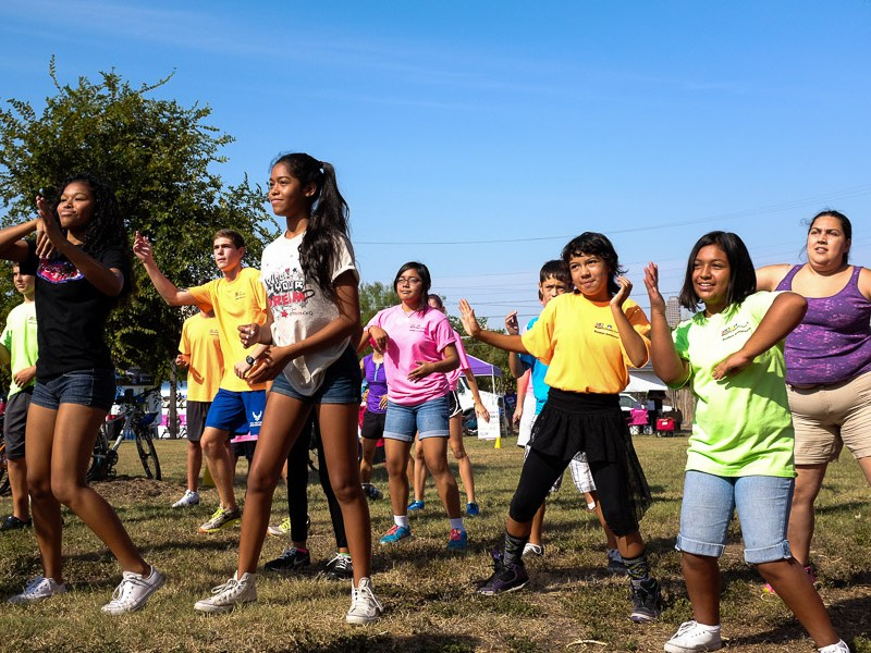 People gather for a zumba class in Dignowity Park. Photo by Scott Ball.