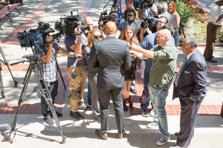 Reporters surround district two Councilman Alan Warrick. Photo by Scott Ball.