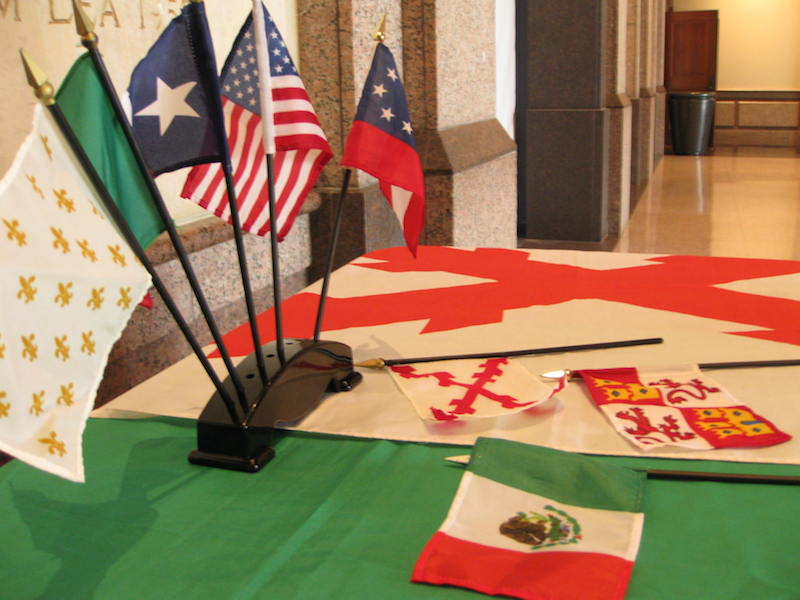 """Dan Arellano's """"Seven Flags of Texas"""" rest on his lecture podium. Photo by Vedant Peris."""