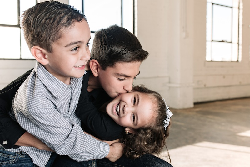 William, 10, Joshua, 5, and Juliette, 4, are featured in this year's CASA Gallery of Hope. Photo by Josh Huskin.