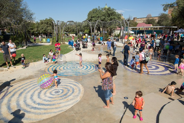 Visitors enjoy cooling off at the splash pad under sunny skies at Yanaguana Garden. Photo by Rachel Chaney.