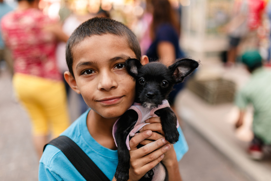 Abraham, 12, and his dog, Delta, pose for a photo during Artpace's Chalk it Up 2015. (Photo: Josh Huskin)