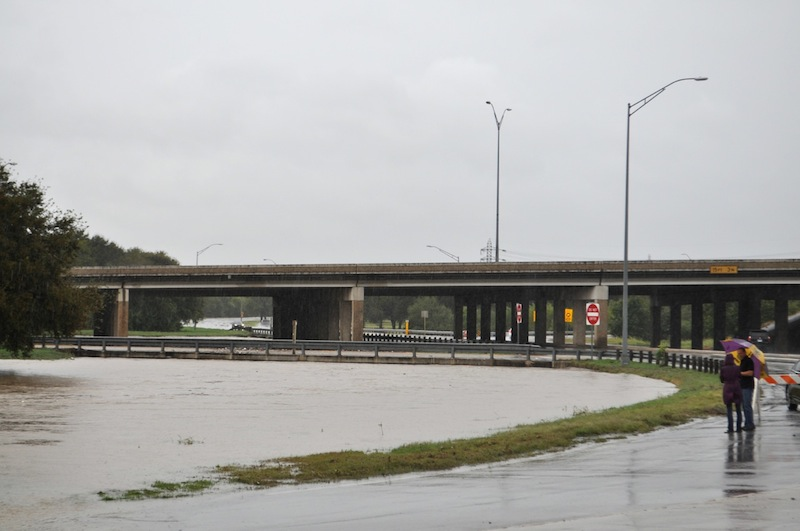 The East Basse Road exit is flooded after heavy weekend rains on Oct. 24, 2015. Photo by Iris Dimmick.