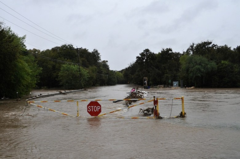 Jones Maltsberger Road is flooded at East Basse Road after heavy weekend rains on Oct. 24, 2015. Photo by Iris Dimmick.