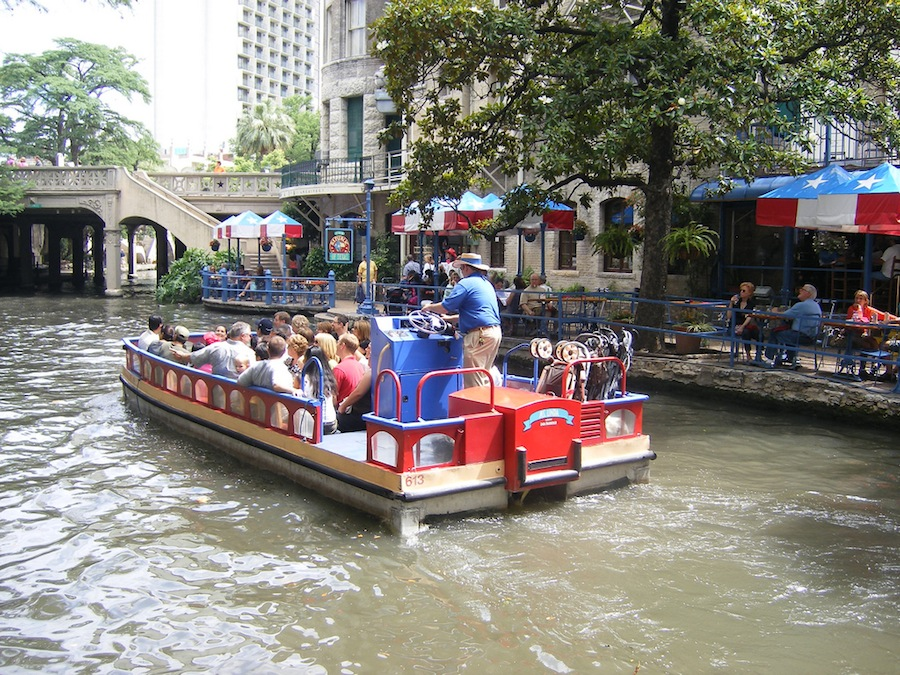 A river barge operated by Rio San Antonio Cruises in downtown San Antonio. Photo by Flickr user Mike Whaling.