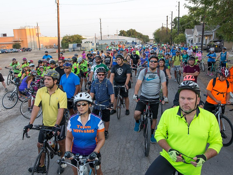 Cyclist wait at the starting line on Cherry Street. Photo by Scott Ball.