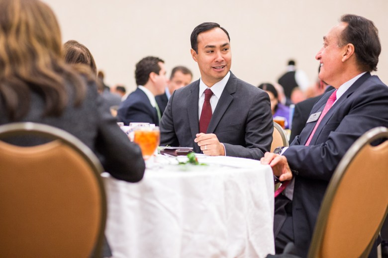 Henry Cisneros speaks with State Representative Joaquin Castro during a luncheon hosted by the San Antonio Chamber of Commerce. Photo by Scott Ball.