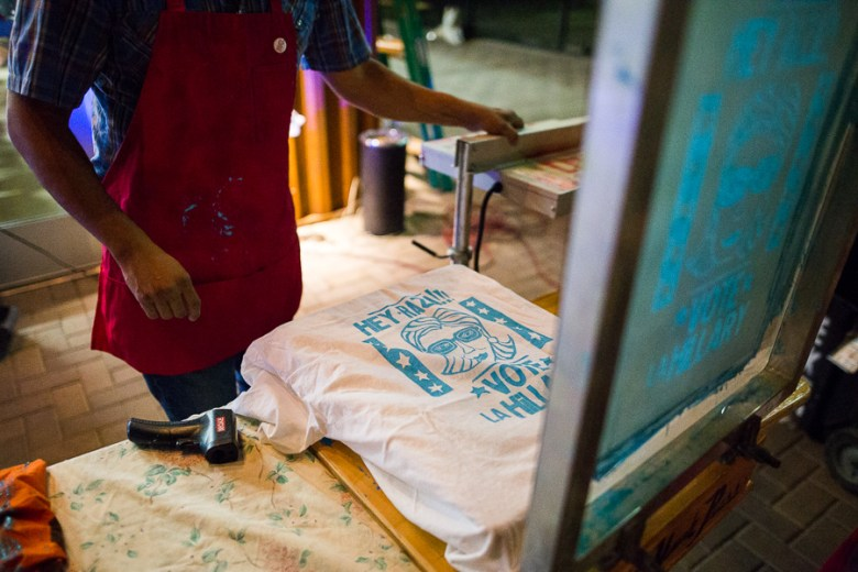 Cruz Ortiz makes custom shirts in support for Hillary Clinton. Photo by Scott Ball.