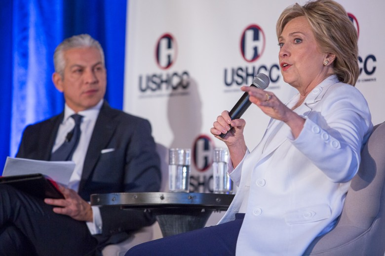 Presidential candidate Hillary Clinton (left) responds to a question from United States Hispanic Chamber of Commerce President and CEO Javier Palomarez. Photo by Scott Ball.