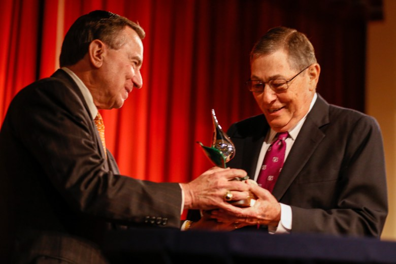 Ed Kelley gives the 2015 Water for Life Award to Mike Beldon, first chair of the Edwards Aquifer Authority. Photo by Scott Ball.