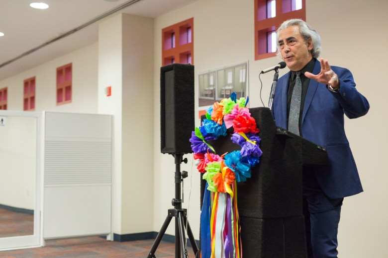 Local author John Phillip Santos speaks at the future home of the Latino Collection & Resource Center at the Central Library. Photo by Scott Ball.
