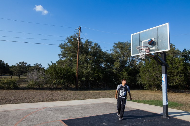 Virgil Romo plays basketball. Photo by Scott Ball.