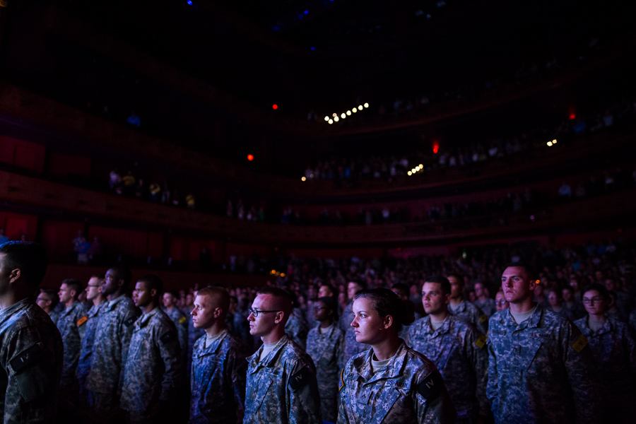Soldiers stand as a performance of the National Anthem plays. Photo by Scott Ball.
