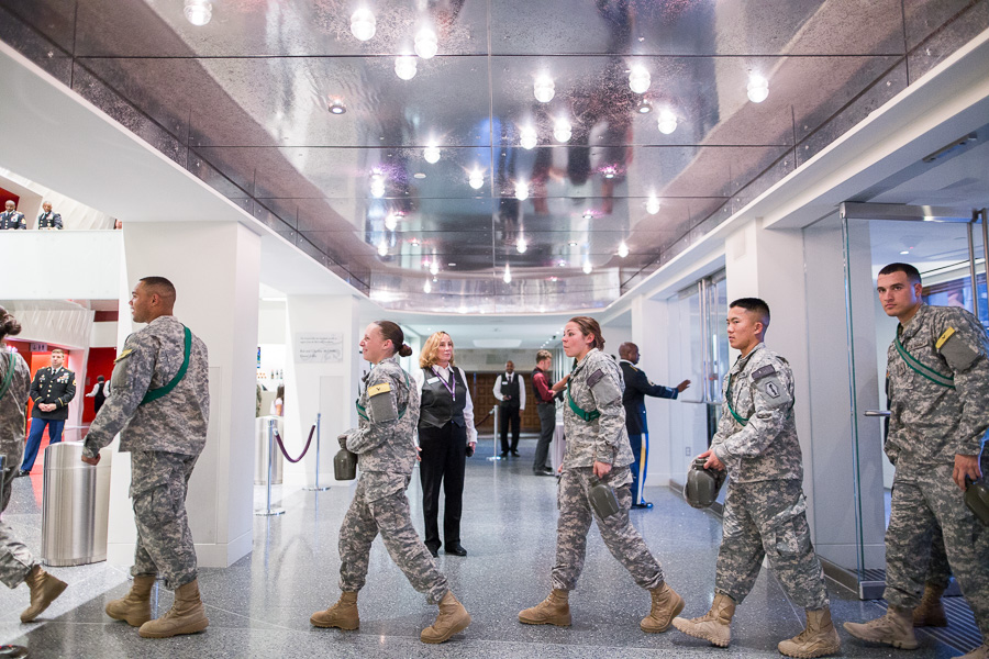 Soldiers enter through the lobby of the Tobin Center. Photo by Scott Ball.