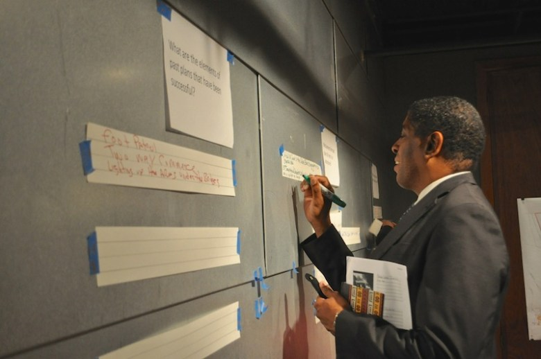 Rev. James Amerson gives written feedback on how St. Paul Square can improve. Photo by Iris Dimmick.