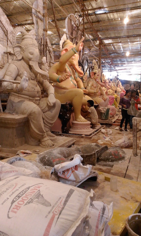 Workers painting huge plaster statues of Ganesh ordered by neighborhood groups for the Ganesha Chaturthi. Photo by Jillian Reddish.