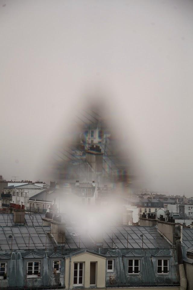 Rain falls in Paris. Photo by Shane Vives Atsara Woodward.