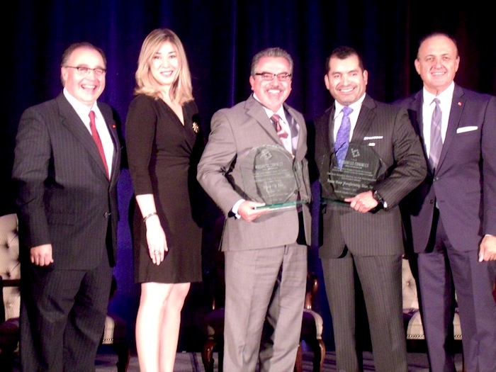 Brooks City Base President and CEO Leo Gomez (center) and Mario Lozoya, government relations director at Toyota Motor Manufacturing Texas (second from right), receive the Max Navarro Excellence in Procurement Awards during the Business Connect event from SAHCC President and CEO Ramiro Cavazos (left), Elizabeth Navarro (second from left) and SAHCC Board Chairman Al Aguilar (right). Photo by Edmond Ortiz.