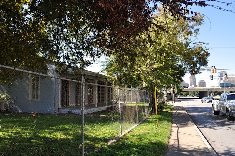The historic Dullnig-Schneider House is fenced off next to Healy-Murphy Park. Photo by Iris Dimmick.