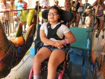 A young girl rides a ride at Morgan's Wonderland. Photo courtesy of Morgan's Wonderland.