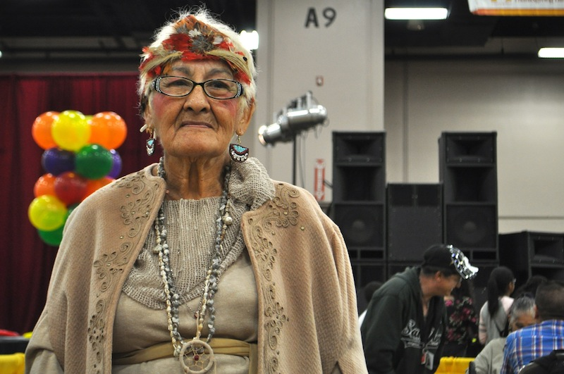 Margaret Arriaga, 81, wore an ornate outfit in honor of Native Americans. Last year, she was a pilgrim. Photo by Iris Dimmick.