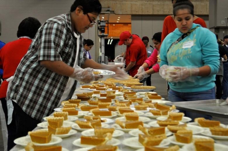 Volunteers plate pumpkin pie. Photo by Iris Dimmick.