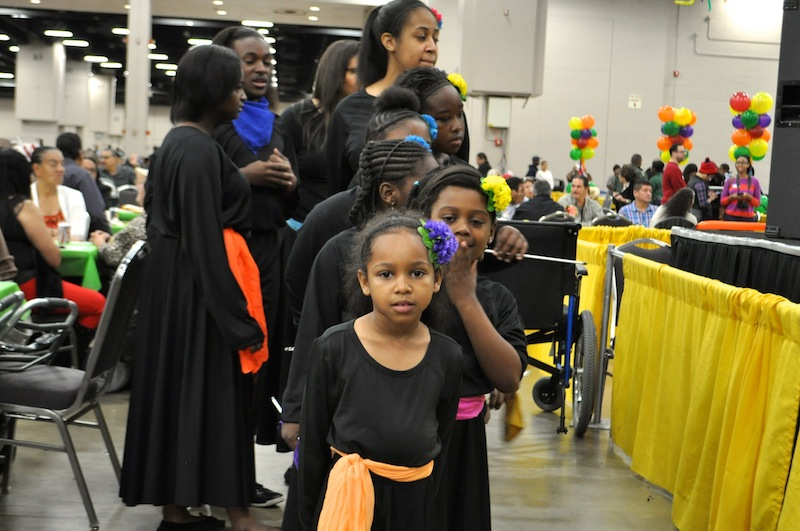 Young members of the Antioch Missionary Baptist Church prepare to go on stage to sing and dance. Photo by Iris Dimmick.