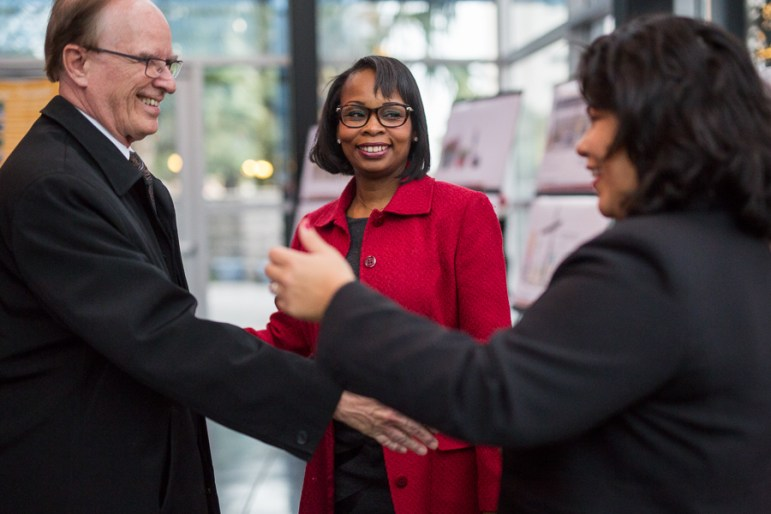 Nelson Wolff (left) greets Mayor Ivy Taylor and Councilwoman Rebecca Viagran (District 3). Photo by Scott Ball.