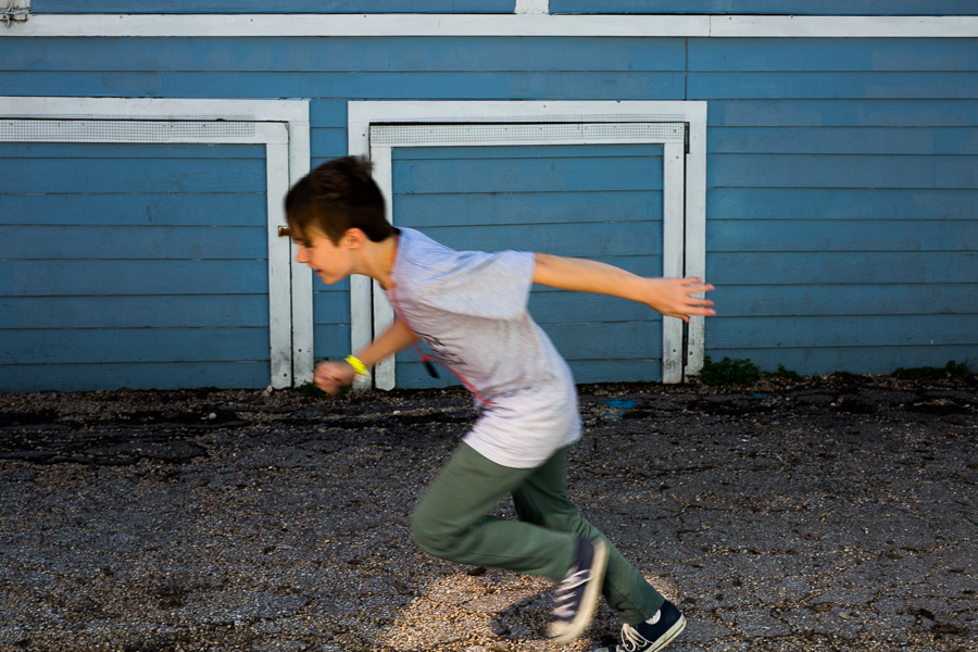 A student zooms past his classroom building on his way to recesss. Photo by Scott Ball.