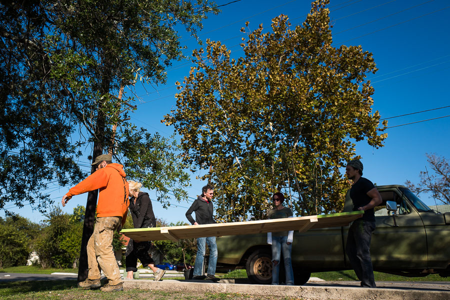 Dignowity Hill residents carry the table top to Lockwood Park. Photo by Scott Ball.