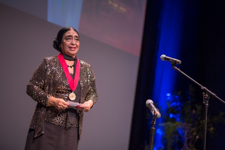 Honored artist Teresa Champion gives her acceptance speech. Photo by Scott Ball.