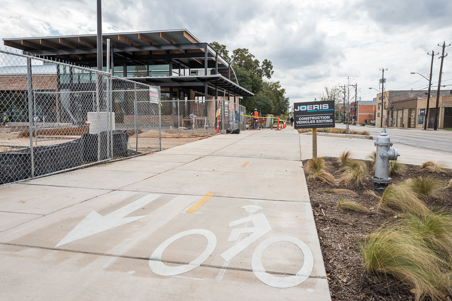 A bike path stretches parallel with South Flores in front of the newest H-E-B set to open December 2nd, 2015. Photo by Scott Ball.