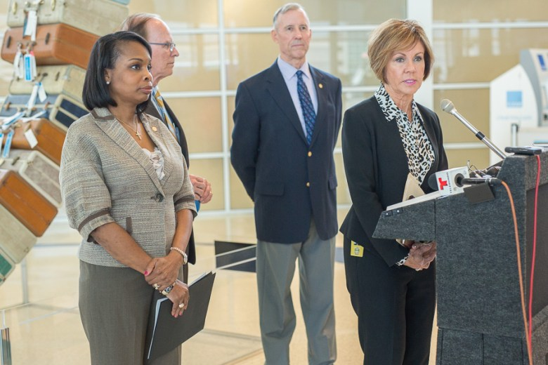 (From left) Mayor Ivy Taylor, Bexar County Judge Nelson Wolff, and Councilmember Mike Gallagher (D10) look on as City Manager Sheryl Sculley answers questions from reporters. Photo by Scott Ball.
