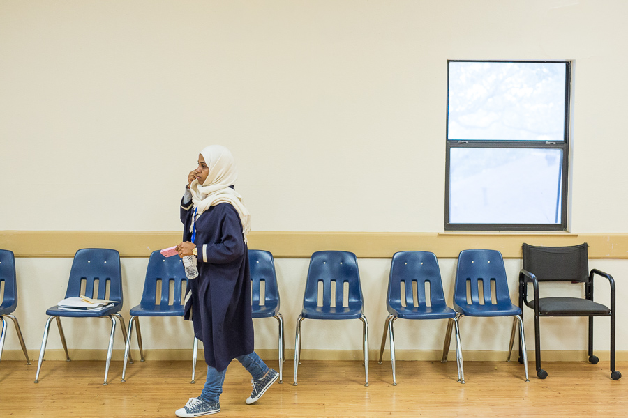 Majdah Gombri, an intern at North Saint Mary's University walks out of the parish after the session concludes. Photo by Scott Ball.