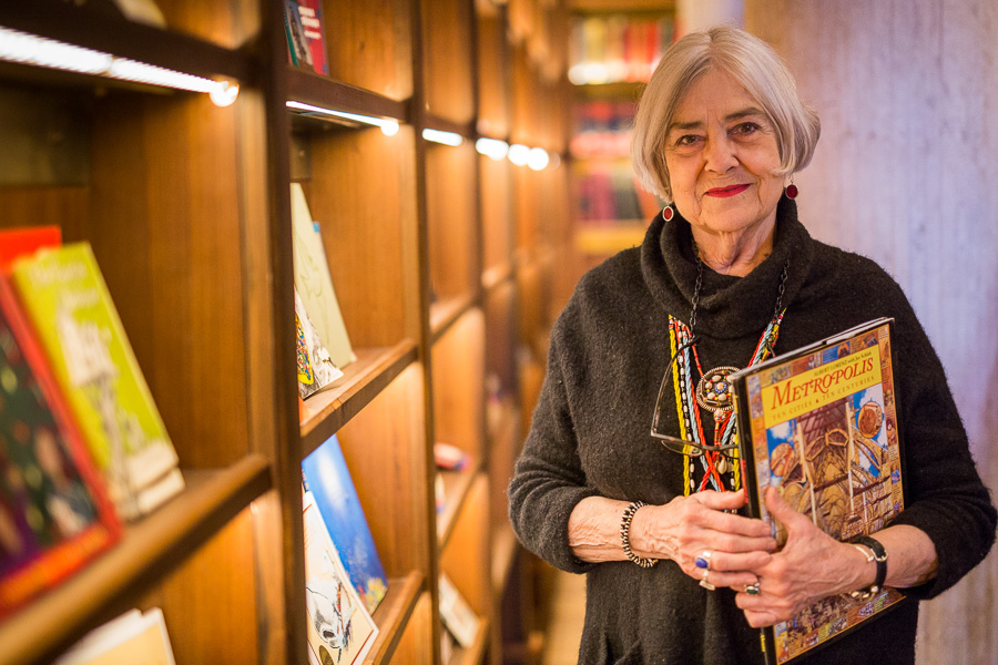 Sherry Kafka Wagner stands amid her book collection in the Hotel Emma library. Photo by Scott Ball.