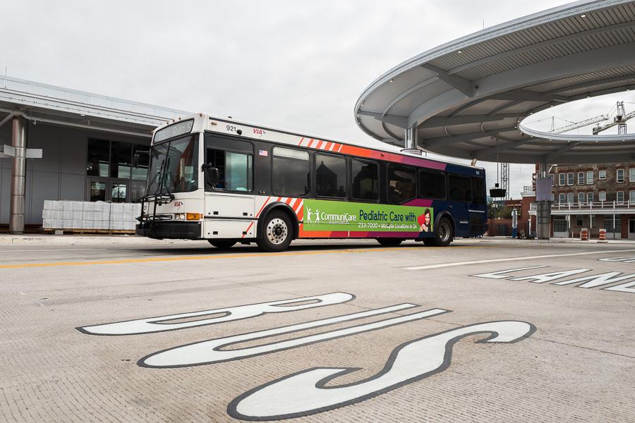 A Via bus exits Centro Plaza. Photo by Scott Ball.