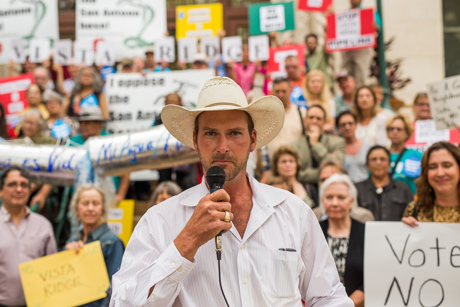 Andy Hovorak addresses fellow protestors in opposition to the Vista Ridge water pipeline in front of City Hall. Photo by Scott Ball.
